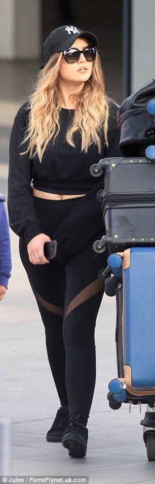 Legs eleven! Perrie's leggings featured mesh panels that offered a look at her toned pins