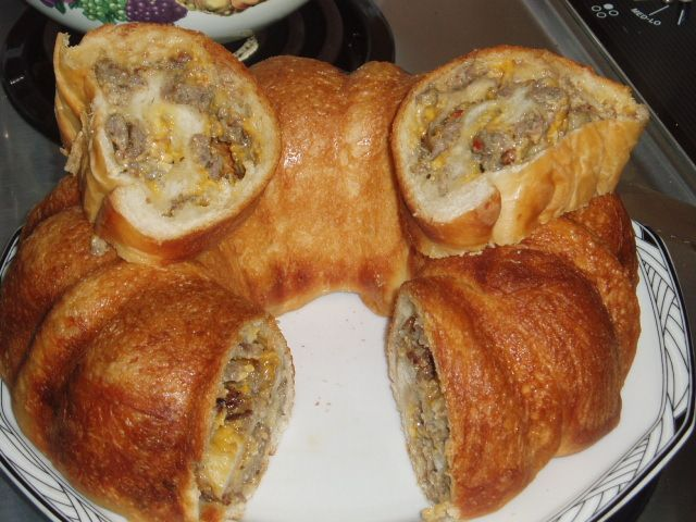"Sausage & Cheese Bread baked in bundt pan. ""Great buffet or brunch party.""  I want to try this for tailgate!"