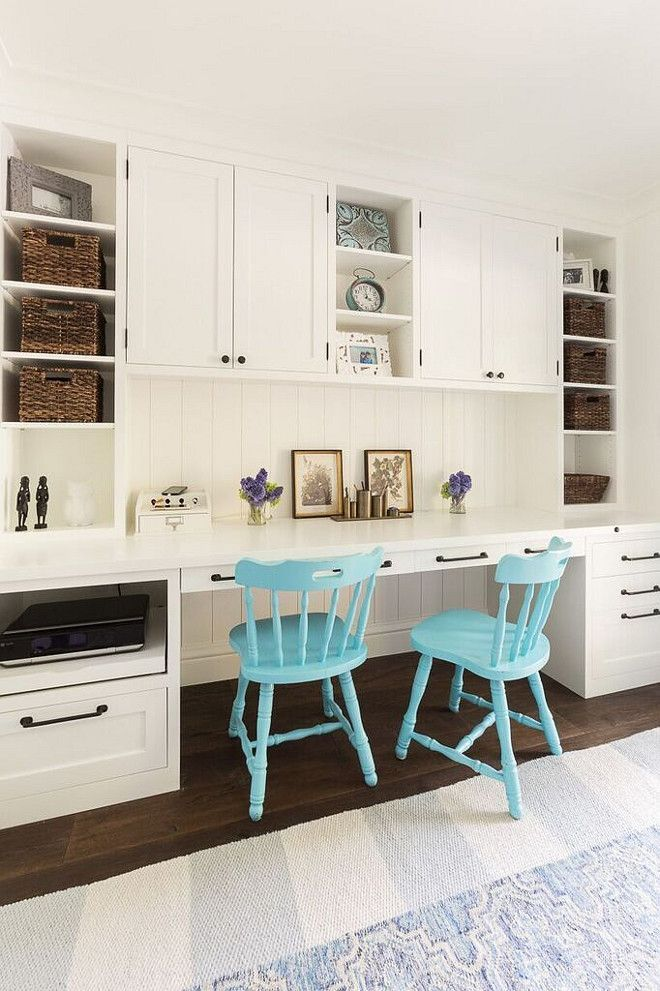 Beautiful, built-in home office space with shaker cabinets painted Simply White by Benjamin Moore, iron hardware, turquoise chairs, open shelving and wicker storage baskets | Heydt Designs.