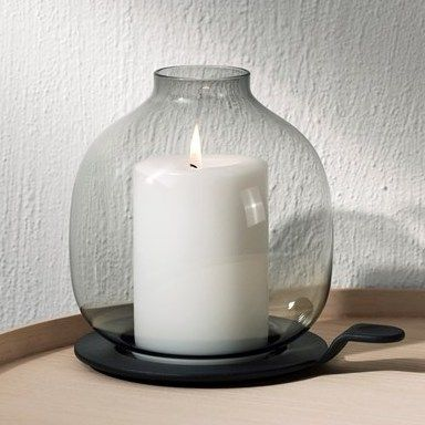 A modern hurricane lamp that's all about a cozy look and a throw back to classic candle holders.