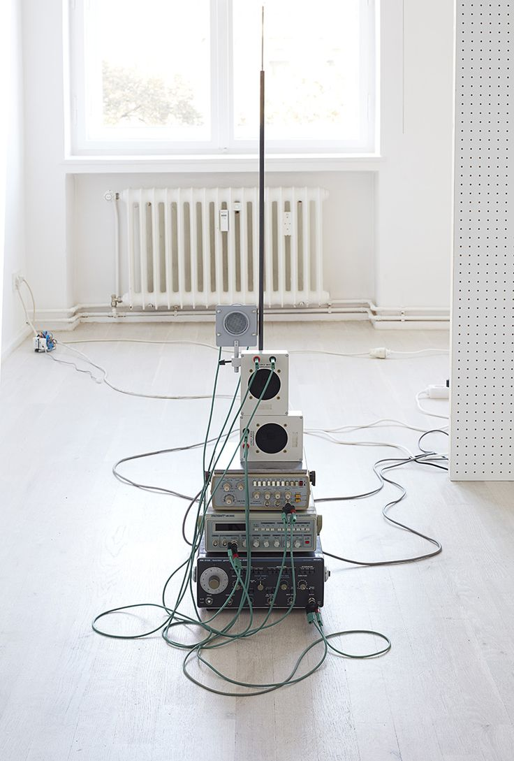 Nina Canell | Flexions In collaboration with Robin Watkins 2016 Memory wire, pegboard, frequency generators, loudspeakers, cables, electrical connectors, DC generators, relay-timers, proximity sensor, wood, steel