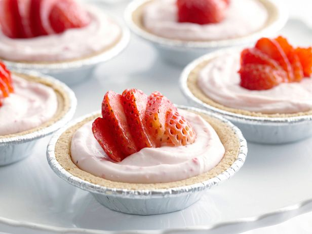 Individual No-Bake Strawberry Cheesecakes Recipe : Rachael Ray : Food Network - Rachael's individual cheesecakes have a beautiful pink blush to them and couldn't be easier to make, thanks to help from store-bought crusts.