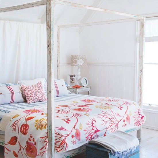 Be inspired by the seaside  As a pretty alternative to classic blue, red also works well combined with a coastal white scheme in a bedroom. Here, a coral bedspread thrown over striped blue bed linen evokes a distinctively seaside feel.