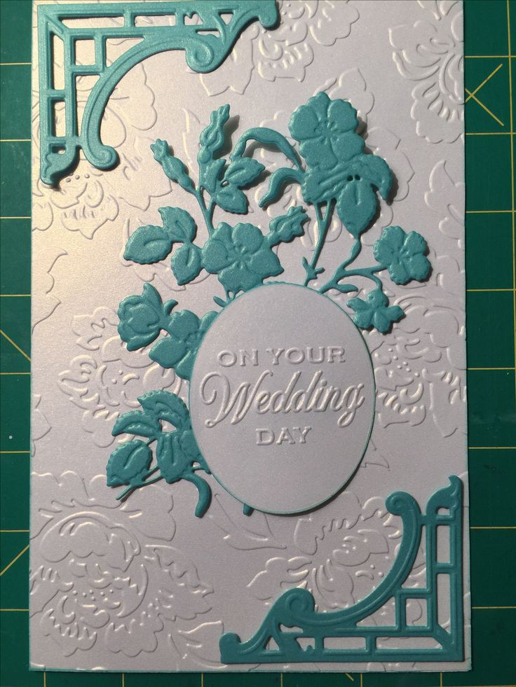 Wedding card. All dies are by Anna Griffin: flower vine, mix and match embossing folder tag, corner die. Embossed background by Theresa Collins.