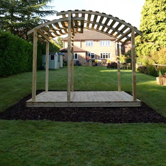 <p>Crafted wooden structures with eye-catching designs from Forest include the Portigo Pergola.  Its contemporary style shows off an impressive double arced slatted roof which allows light through whilst still providing a little shade.  Supplied flat packed and unpainted with all fixings and instructions provided.  <b>Please Note:</b> Deck not included </p>