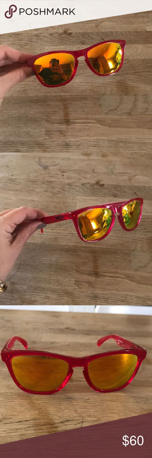 Oakley frogskin sunglasses 🐸 Oakley frogskins. Polarized lenses. Have some scratches on the lense that are small. Refer to pics. Super cute but I'm moving and need the money. Hot pink and orange/ yellow fire lenses. Oakley Accessories Glasses