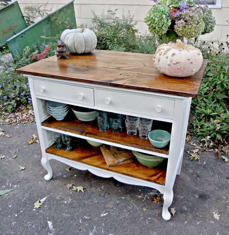 Kitchen Island Made from a Salvaged Dresser - lower drawers replaced with shelves and shelf brackets attached to a wide top create a small but efficient kitchen island - via Heir and Space