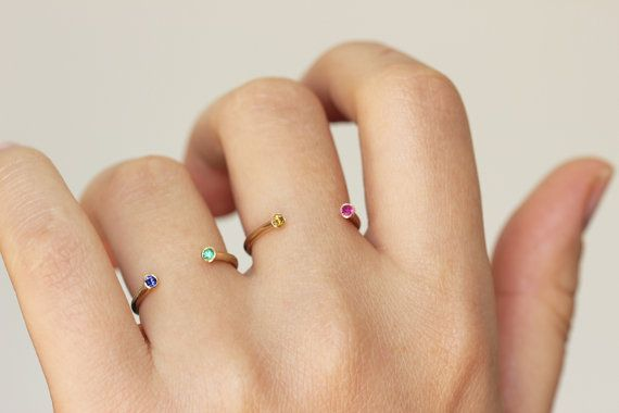 Collect a stack of dual birthstone rings.