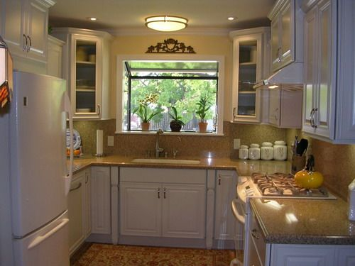 U-shaped traditional small kitchen remodel white cabinets ideas
