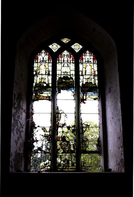 Remnants of stained glass window in the old abandoned church in Rathcormac, Ireland.