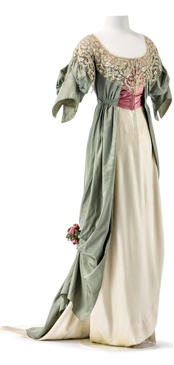 An Edwardian evening dress from Jeanne Paquin's spring/summer collection, c.1912, of turquoise, rose and ivory silk with lace detailing.