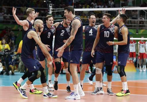 US men's volleyball reaches Rio semis with fourth straight win:  August 17, 2016  -     The United States volleyball team celebrates a victory over Poland in a men's quarterfinal volleyball match at the 2016 Summer Olympics in Rio de Janeiro, Brazil, Wednesday, Aug. 17, 2016.