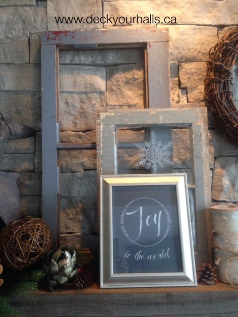 Love layering the elements on a fireplace mantel.  Old window panes with a DIY framed simply Christmas JOY. #joytotheworld