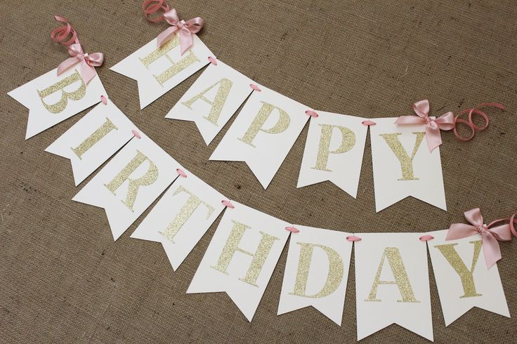 "- Ivory heavy cardstock - Pink satin ribbon and bows - Gold glitter letters - 3 inches tall - ""HAPPY"" spans 20 inches, ""BIRTHDAY"" spans 30 inches - Additional 12 inches of ribbon on each end *Handmade"