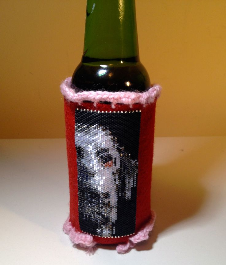 Beer Mug Holder made of felt & crochet trim & a beautiful lab peyote stitch pattern.  I sell the mug for $65, made to order.  The peyote pattern come from MyCraftAsylym on Etsy.  manoncreativemoments@gmail.com