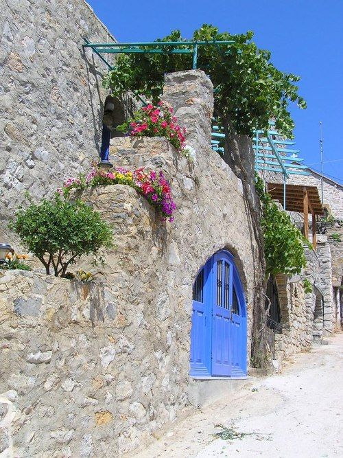 while walking down the alley, the scents of the flowers and the landscape capture ones spirit.  Avgonyma village, Chios  Source:  pixdaus.com