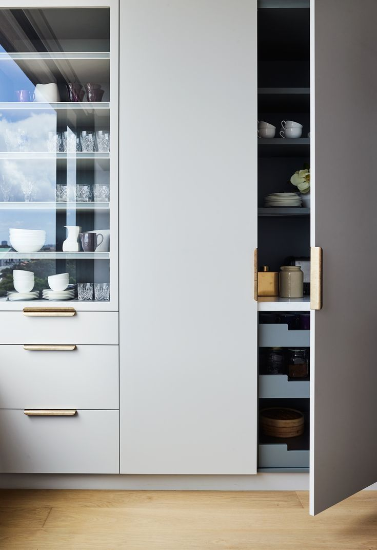 Simple Tall Pantry Doors Mixed With The Stacked Drawers And Glass Cabinet Adjacent Kitchen Interior Home Interior Design Contemporary Interior
