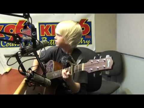"Carson Lueders, age 8, sings his original ""Big Mouth Bass"" on KIX96 radi..."