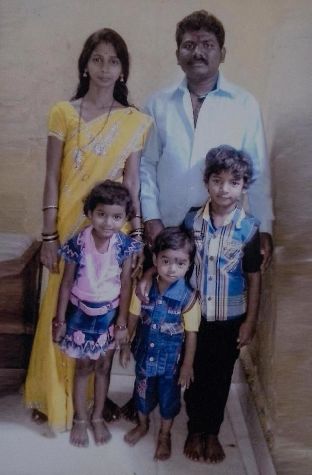 Sunny Pawar, 8, (front right) with his father Dilip Pawar, 32, (back right) mother Vasu Dilip Pawar, 27 (back left), four-year-old brother Jignesh Pawar (front centre) and six-year-old sister Divisha Pawar (front left) in Mumbai, India.