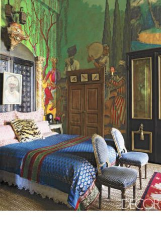 For the master bedroom of her San Antonio, Texas, home, decorator Gwynn Griffith had her son paint a Persian landscape on the walls; the headboard is made from faux-marble pilasters and a pair of Indian pierced-wood doors, and the chairs are Italian.