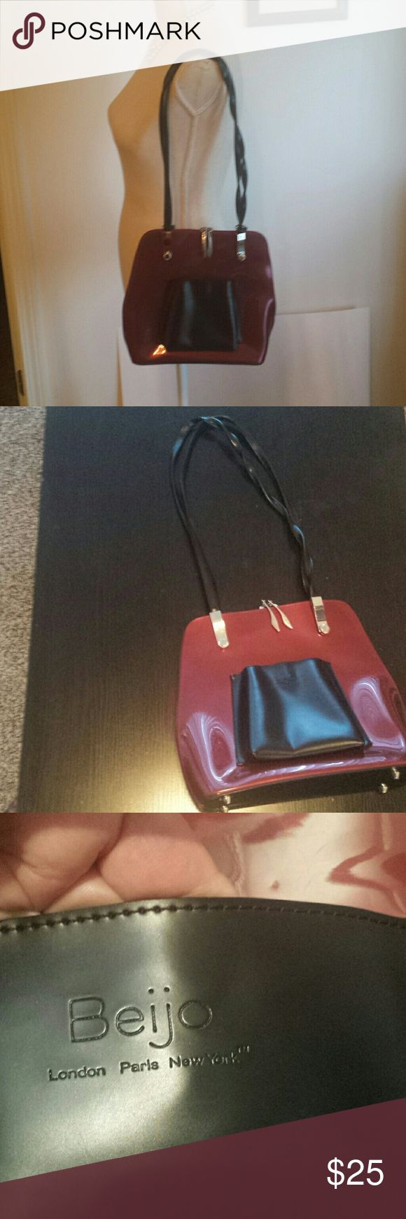 "EUC Beijo red and black patent leather hand bag. EUC Beijo red wine and black patent leather purse. Snap on front pocket is broken but you can't tell looking at it. Drop is approximately 13"". Beijo Bags Shoulder Bags"