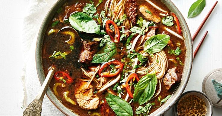 This soup, a rich bowl of goodness, was originally served by vendors in canoes as they paddled the canals of Bangkok, hence the name 'boat noodles'.