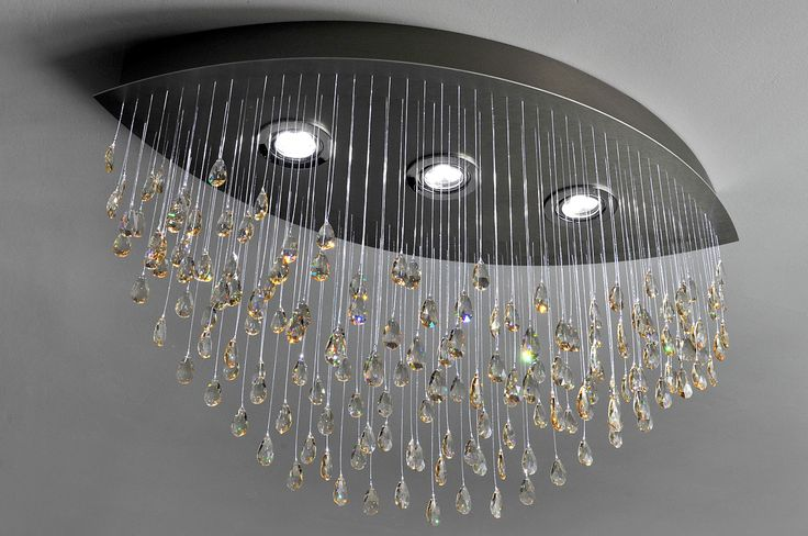 Modern chandelier made of crystals hanging on sparkling fiber optics. Serial production. MADE WITH SWAROVSKI ELEMENTS.