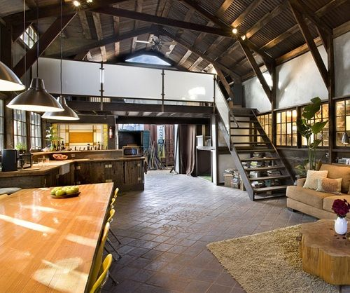 Converted barn with more open space - like the warmth of the brown with yellow accents