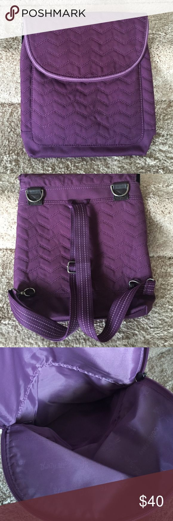 Thirty One Vary Backpack Purse Convertible bag that can be worn four ways. Strap adjusts to allow styles for purse, crossbody or two backpack variations. Lots of pockets and storage options. Only used once. Thirty One Bags