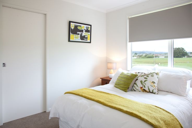 Guest bedroom with a sliding door to the ensuite.