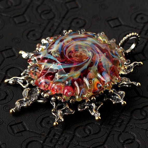 Sun pendant with handmade red glass bead and enameled