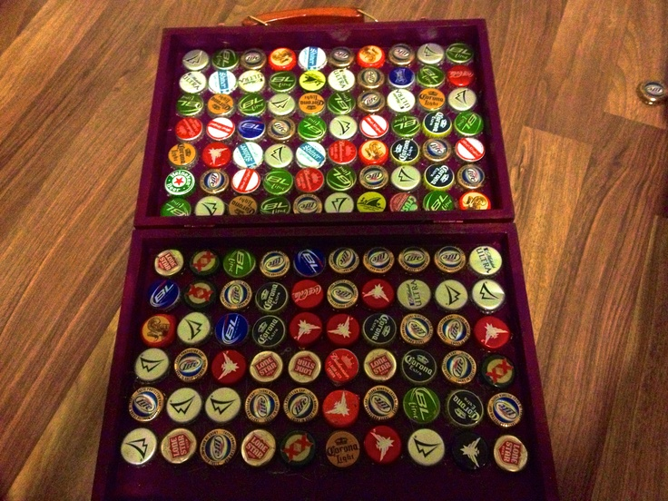 bottles caps in a wooden thin suitcase