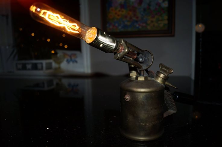 Blowtorch lamp. Old kerosine blowtorch fitted with an E14 lamp holder and a weak (15W) bulb.