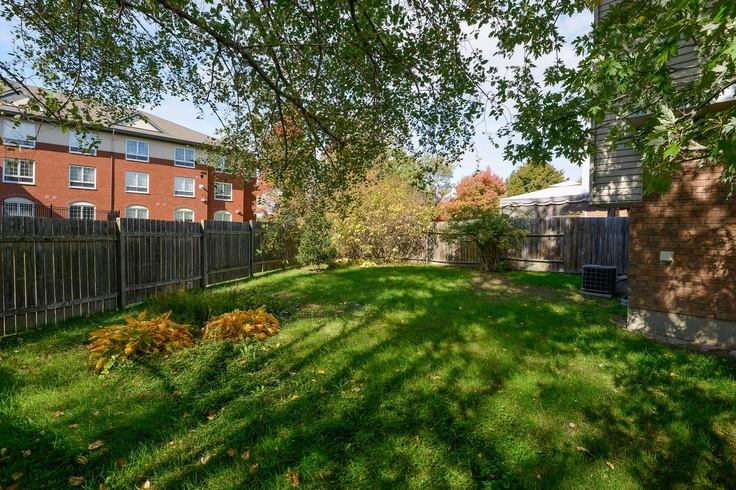 The sunny, private backyard is the largest on the crescent, the backing on to the courtyard of a seniors' residence. Talk about quiet neighbours!
