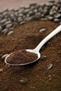 Use Old Coffee Grinds in your garden. Tomatoes love it!! They add nitrogen to the soil, boost foliage growth and deter pests. If you don't drink much coffee, Starbucks gives away coffee grounds in their Grounds for Gardens programs.