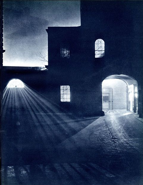 This picture gallery features atmospheric images of London streets in the 1930s, before the Blitz, before the clean air act, before sodium lighting. It was a city of gloomy back streets lit by dim lamps, with forbidding alleys and the occasional welcoming light. The photographs are from a book called London Night, by John Morrison and Harold Burdekin, which was published in 1934.