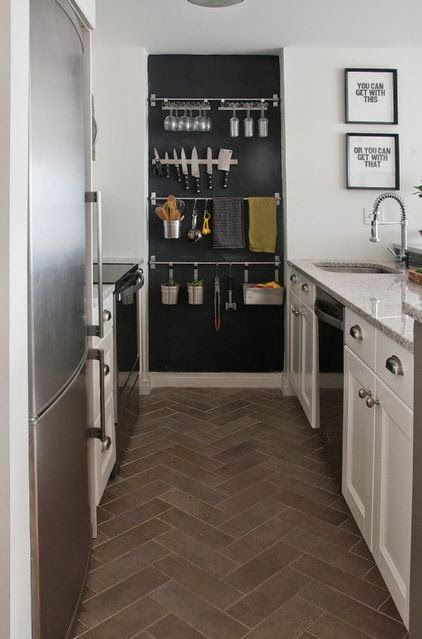 The Galley Kitchen - THE LITTLE IKEA (LIKE) HANGING RODS ON THE BACK WALL ARE GREAT FOR ADDITIONAL STORAGE IN ALL ROOMS OF THE HOUSE.