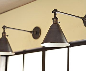 Spotlight Your Work Area  Wall-mount lights with a bronze finish illuminate the work sink.