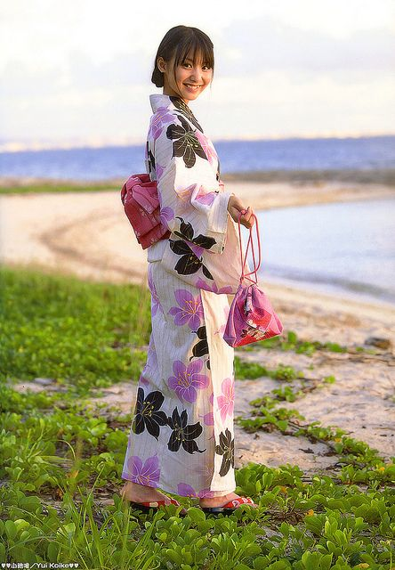 A Japanese woman wearing yukata. Yukata is a casual summer kimono worn by men and women made out of cotton.