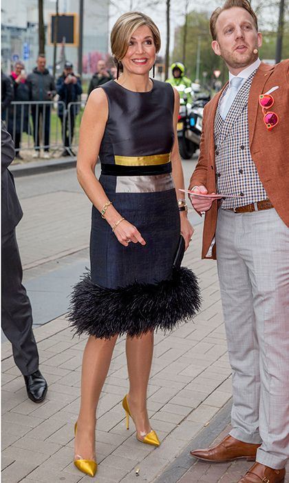 Wearing a feather-trimmed dress and yello heels, Queen Maxima of the Netherlands was a study in color block accessorizing as she opened StudyPortals headquarters in Eindhoven.