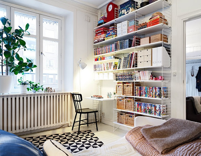 workspace corner - white walls and floor to ceiling shelves
