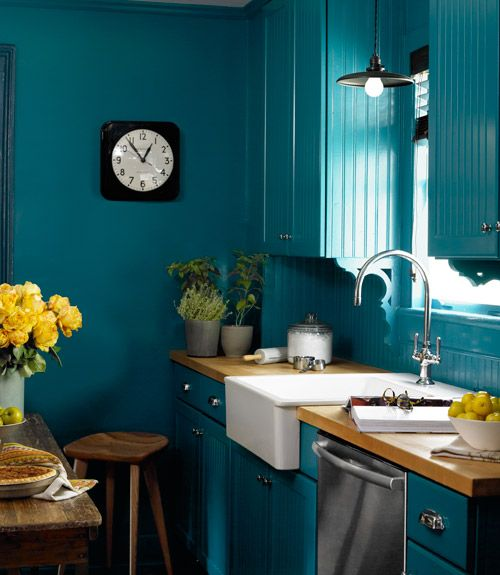 Ikea's white farmhouse sink pops against Varsity Blues by Benjamin Moore that covers the walls, cabinets, and trim in this upstate New York kitchen. The homeowner bought the clock at the Hudson, New York, shop Rural Residence.   - CountryLiving.com