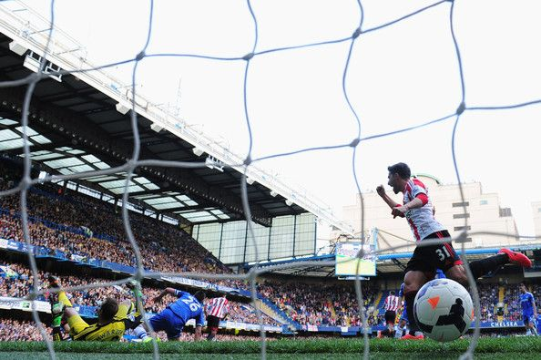 Fabio Borini (R) celebrates as team mate Connor Wickham (unseen) of Sunderland scores past Mark Schwarzer the Chelsea goalkeeper during the ...
