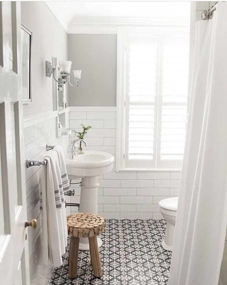 Gorgeous grey bathroom with white and black accents