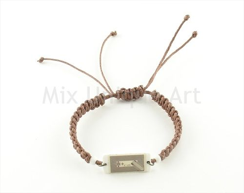 NFC bracelet. Visible tag with brown cord