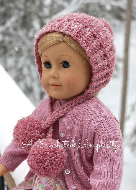 """""""Winter Poms"""" 18″ Doll Hat This cute winter hat was designed for my daughter's dolls. She had asked for a snowsuit for them for Christmas and needed a hat to coordinate. So what d…"""