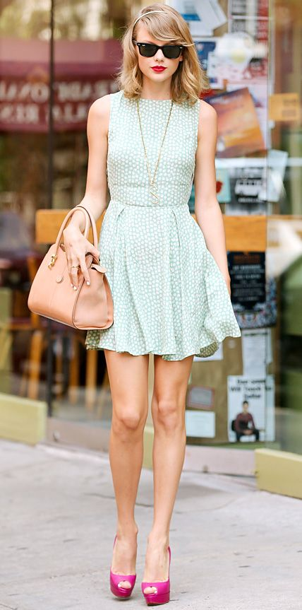 "Taylor Swift recently stepped out in another one of her signature sweet looks, accessorizing her printed mint green dress with wayfarers, an ""S"" Lulu Frost necklace (in honor of BBF Selena Gomez's birthday), a nude Tod's handbag and fuchsia peep-toes."