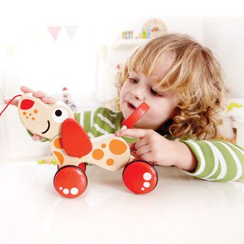 Crafted from maple wood and coloured with non toxic paints this gorgeous puppy is ready to be taken for a walk. Pull  along toys help children to develop motor skills balance and movement and are the perfect gift for babies first steps!