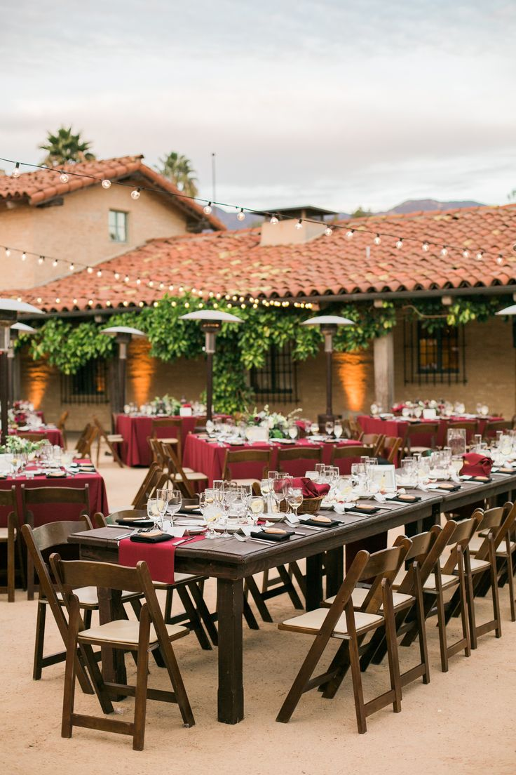The Santa Barbara Historic Museum is one of Santa Barbara's premiere event locations and the decor can be natural and minimal.  Wood ranchero tables with chairs and pops of color with napkins and centerpieces are all that's needed to wow.  Photo Credit:  Beaux Arts Photography