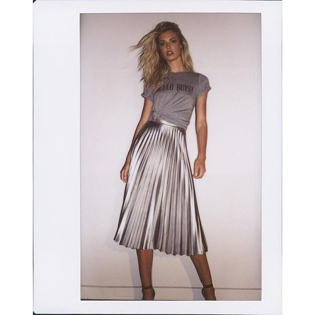Pleat on Repeat! Revitalise your night out look with a high shine pleat skirt and knotted statement tee. Shop the look in-store and online now with our Hello Boys Tee and Metallic Pleat Skirt. #bardot